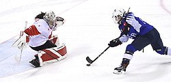 February 22, 2018 - Pyeongchang, South Korea - JOCELYNE LAMOUREUX-DAVIDSON of Team USA slips what turns out to be the winning penalty shot past Canada goalie SHANNON SZABADOS in the 3-2 overtime win in the Women's Gold Medal Ice Hockey game Thursday, February 22, 2018 at Gangneung Hockey Centre at the Pyeongchang Winter Olympic Games. Photo by Mark Reis, ZUMA Press/The Gazette (Credit Image: © Mark Reis via ZUMA Wire)