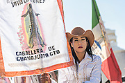 A Mexican cowgirl waits for the start of Catholic mass on Cubilete Mountain at the end of the annual Cabalgata de Cristo Rey pilgrimage January 6, 2017 in Guanajuato, Mexico. Thousands of Mexican cowboys and horse take part in the three-day ride to the mountaintop shrine of Cristo Rey.