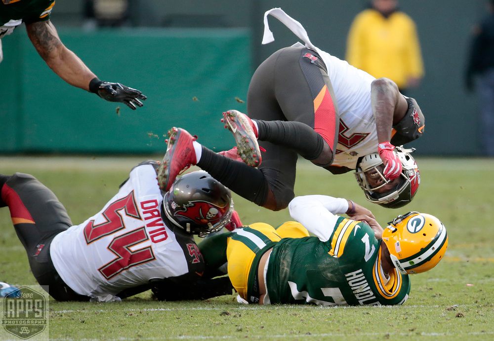 Green Bay Packers quarterback Brett Hundley (7) runs for 18-yards in Overtime. Tampa Bay Buccaneers strong safety Keith Tandy (37) tries to chase in down. <br /> The Green Bay Packers hosted the Tampa Bay Buccaneers at Lambeau Field in Green Bay,  Sunday, Dec. 3, 2017. The Packers won in 26-20 in Overtime.   STEVE APPS FOR THE STATE JOURNAL.