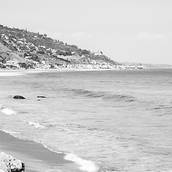 Manibu California coastline black and white panoramic photo. Malibu is a beach city in Southern California in the United States of America. Panorama photo ratio is 1:3. Copyright ⓒ 2015 Paul Velgos with All Rights Reserved.