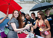 Jul 14, 2010 - Washington, District of Columbia, U.S., -   Elizabeth Kucinich, wife of Senator Dennis Kucinich, receives a veggie hot dog from chili-pepper bikini-clad men's magazine model and vegetarian Vida Guerra as she hands out veggie chili dogs on Capitol Hill on Wednesday. The event marks National Veggie Dog Day--PETA's answer to the meat industry's National Hot Dog Month.. (Credit Image: © Pete Marovich/ZUMA Press)