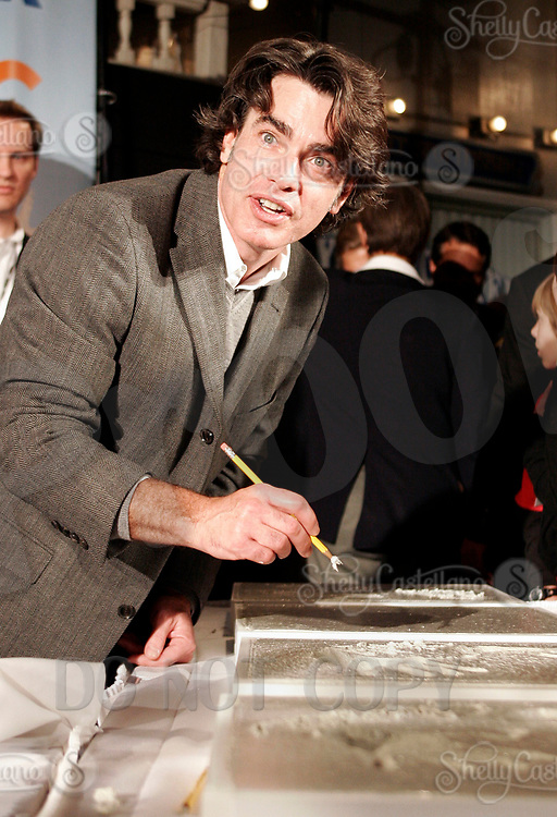 Oct 28, 2004; Newport Beach, CA, USA; PETER GALLAGHER of the FOX hit TV show 'The OC' visited the Balboa Penninsula in Newport Beach to get a Key to the City and be immortalized in cement with thier hand prints to be placed at the enterance to the Historic Balboa Pavillion. Peter is signing his name to his hand imprint in wet cement.   Mandatory Credit: Photo by Shelly Castellano/ZUMA Press.