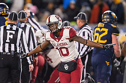 Nov 19, 2016; Morgantown, WV, USA; Oklahoma Sooners safety Steven Parker (10) celebrates after Oklahoma Sooners recover a fumble during the second quarter against the West Virginia Mountaineers at Milan Puskar Stadium. Mandatory Credit: Ben Queen-USA TODAY Sports