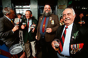 ANZAC (veterans) Day. Vietnam war vets having a couple of beers at a downtown pub after the parade.