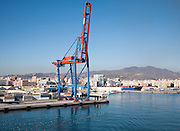 Cranes standing on quayside in the port of Malaga, Spain