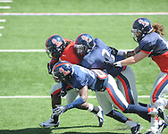 Nicholas Parker (4) is chased by Brishen Mathews (13), Quintavius Burdette (2), and Carlos Davis (20)  at Ole Miss football scrimmage at Vaught-Hemingway Stadium in Oxford, Miss. on Saturday, April 6, 2013.