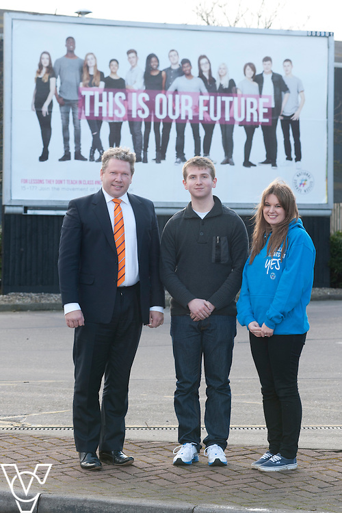 Pictured is, from left, Lincoln MP Karl McCartney, NCS graduate Harry Walker and NCS Communications Coordinator Brittany Welch next to the NCS billboard in Lincoln.<br /> <br /> Date: January 15, 2015