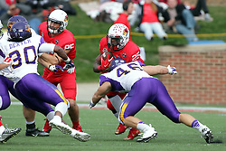 03 October 2015:  Jared Farley(46) lunges for runner Marshaun Coprich(25). NCAA FCS Football between Northern Iowa Panthers and Illinois State Redbirds at Hancock Stadium in Normal IL (Photo by Alan Look)