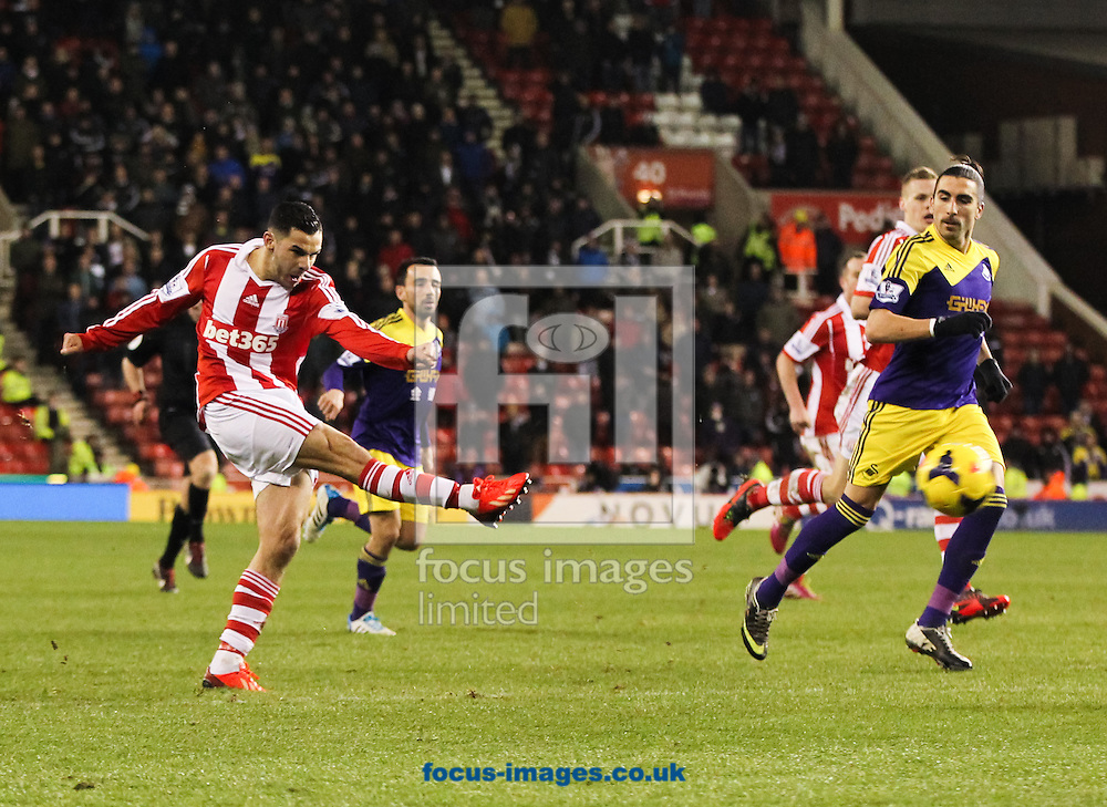 Oussama Assaidi (left) of Stoke City ames a shot at goal during the Barclays Premier League match at the Britannia Stadium, Stoke-on-Trent<br /> Picture by Tom Smith/Focus Images Ltd 07545141164<br /> 12/02/2014