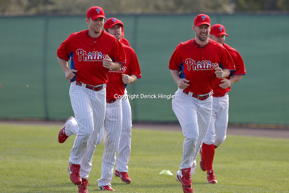 February 22, 2011; Clearwater, FL, USA; Philadelphia Phillies relief pitcher Brad Lidge (left) and starting pitcher Cliff Lee (33) workout with teammates during spring training at Bright House Networks Field. Mandatory Credit: Derick E. Hingle-US PRESSWIRE