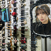 Nai Nai, a 23-year-old live-streamer in Shanghai, China, shops for accessories in Wuhan city. 