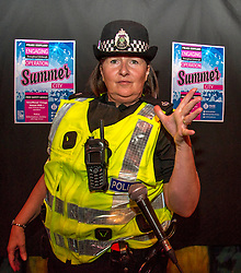 Pictured: Superintendent Lesley Clark 'drops the mike'<br /> Superintendent Lesley Clark discussed key safety messages being promoted during the operation over the period of the Edinburgh Festival, and unveiled this year's Operation Summer City mascot, Amanda the Panda<br /> Ger Harley | EEm 2 August  2017