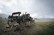 A vintage wagon, or buckboard, stands against an approaching storm on the edge of the Jicarilla Apache Indian Reservation, Northern New Mexico.