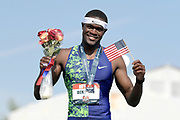 Jul 27, 2019; Des Moines, IA, USA; Rai Benjamin poses with United States flag after winning the 400m hurdles in 47.23 during the USATF Championships at Drake Stadium.