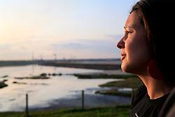 CANADA ALBERTA FORT MCMURRAY 20JUL09 - Greenpeace campaigner Melina Laboucan-Massimo stands outside the Syncrude upgrader plant and tailings pond north of Fort McMurray, northern Alberta, Canada...jre/Photo by Jiri Rezac / GREENPEACE..© Jiri Rezac 2009