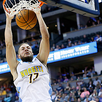 06 March 2016: Denver Nuggets center Joffrey Lauvergne (77) dunks the ball during the Denver Nuggets 116-114 overtime victory over the Dallas Mavericks, at the Pepsi Center, Denver, Colorado, USA.