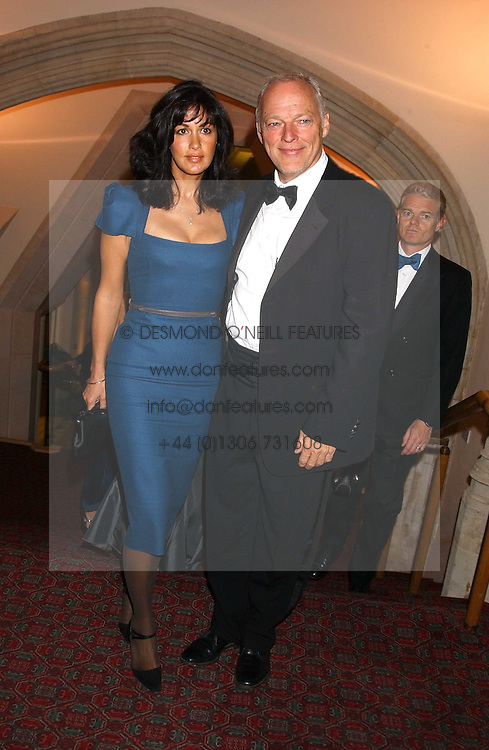 Musician DAVID GILMOUR and his wife POLLY SAMPSON at a dinner to announce the 2005 Man Booker Prize held at The Guilhall, City of London on 10th October 2005.<br />