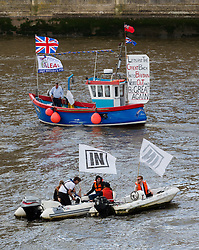 © Licensed to London News Pictures. 15/06/2016. LONDON, UK.  Fishing boats take part in a Vote Leave flotilla and Remain In boats join them outside Parliament in Westminster on the River Thames. Nigel Farage led a pro-Brexit flotilla of fishing vessels along the River Thames to Westminster today, urging people to vote leave in the European Referendum.  Photo credit: Vickie Flores/LNP