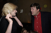 Sophie Dahl and Stephen Fry. Charity evening organised by Orlando Fraser at Woody's. London. 22 November 2001. © Copyright Photograph by Dafydd Jones 66 Stockwell Park Rd. London SW9 0DA Tel 020 7733 0108 www.dafjones.com