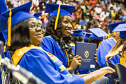 Graduate Zaria Berkitt shows off her diploma.  Charlotte Amalie High School 85th Annual Commencement Program at UVI Sports and Fitness Center.  14 June 2015.  © Aisha-Zakiya Boyd