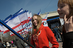 Crimea one day before the referendum. Girl stands in front of crimean flags in a pro Russian rally at Simferopol's Lenin Square. Simferopol, . Saturday, 15th March 2014. Picture by Daniel Leal-Olivas / i-Images