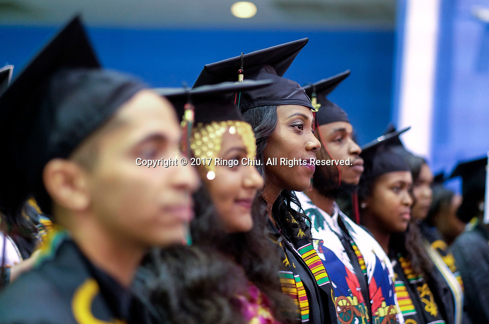 RIVERSIDE, CA - JUNE 11, 2017: Graduates listen to speaker during the Black Graduation Ceremony at University of California, Riverside, Sunday June 11, 2017. (Photo by Ringo H.W. Chiu / For The Times)(Photo by Ringo Chiu)<br /> <br /> Usage Notes: This content is intended for editorial use only. For other uses, additional clearances may be required.