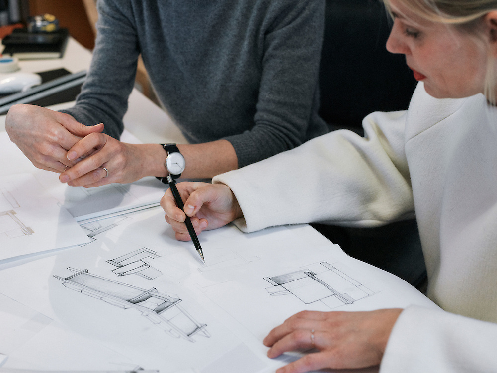 Paris, France. January 11, 2015. Frauke Meyer, the artistic director of the Christian Laigre studio, reviewing a blueprint with one of her designer at the studio. Photo: Antoine Doyen