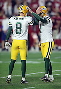 Green Bay Packers punter Tim Masthay (8) and Green Bay Packers quarterback Brett Hundley (7) pat each other on the helmet after Hundley kicks the extra point that ties the score at 20-20, sending the game into overtime during the NFL NFC Divisional round playoff football game against the Arizona Cardinals on Saturday, Jan. 16, 2016 in Glendale, Ariz. The Cardinals won the game in overtime 26-20. (©Paul Anthony Spinelli)