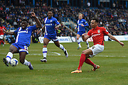 Gillingham defender Deji Oshilaja blocks a shot during the Sky Bet League 1 match between Gillingham and Coventry City at the MEMS Priestfield Stadium, Gillingham, England on 2 April 2016. Photo by Martin Cole.