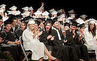 Prospect Mountain High School graduates enjoyed some laughs on stage Friday evening during  their commencement exercises.  (Karen Bobotas/for the Laconia Daily Sun)