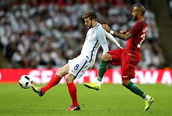Adam Lallana of England passes the ball under pressure from Ricardo Quaresma of Portugal - Mandatory by-line: Robbie Stephenson/JMP - 02/06/2016 - FOOTBALL - Wembley Stadium - London, United Kingdom - England v Portugal - International Friendly