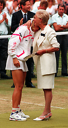 File photo dated 03-07-1993 of The Duchess of Kent hugs Jana Novotna after she lost 6-7 6-1 4-6 to defending champion Steffi Graf in the Women's singles final at Wimbledon.