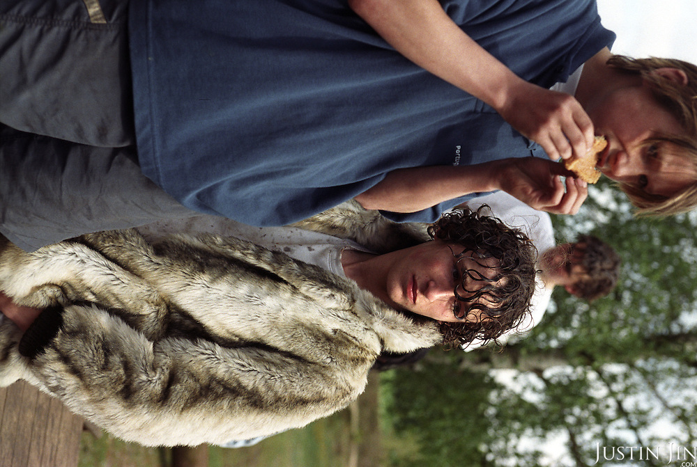 A wealthy Dutch teenager wears fake fur while waiting for his turn to play field games at an Easter camp in middle-Holland...Picture shot in Amsterdam in 2004 by Justin Jin. ..