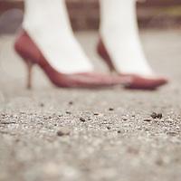 Portrait of women's feet wearing red high heels.