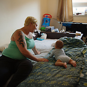 """Samantha is a London homeless, 35 year old single mum with three children aged 11, 9 and an infant of 5 months. She was renting privately until a few months ago when her landlord without much notice gave her an eviction notice that made her homeless. The council of Newham accepted her homeless status in June 2013,but did not perform its legal duty until February 2014.  Prior of this date and to this day, she has relied on friends and family for a place to sleep in. Last February, the council offered an emergency hotel room in Birmingham. For Samantha this would have meant losing her part time work, up-rooting her children   from school and losing all the support from her family and friends. On these basis she refused to go. The council offered then  a hotel room in Ilford. In her words, """"she had to run away. It was filthy to the point that the bed had unwashed and stained covers, broken wardrobe and mould everywhere. The kitchen containing a single stove was serving 23 families. It had no fridge and no cupboards and dirty."""" Shocked she went straight to the council to denounce the place. Admittedly, they sent her to another emergency hotel room, again in Ilford. Equally rotten, she took photo as evidence which have enabled her to put a case forward into review. However, months later she is still living an unsettled life causing her and her children anguish."""