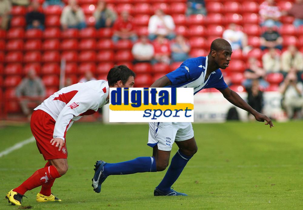 Photo: Mark Stephenson.<br /> Walsall v Birmingham City. Pre Season Friendly. 28/07/2007.Birmingham's new signing Oliver Kapo gets his shirt pulled