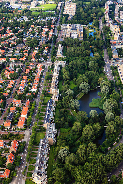 Nederland, Zuid-Holland, Den Haag, 15-07-2012; Sportlaan met flats uit de wederopbouw periode. Links de Vogelwijk..Aan weerszijden van de Sportlaan de 'Atlantikwall strook'. In dit gebied is tijdens de Tweede Wereldoorlog de bevolking geëvacueerd en de bebouwing ontruimd en/of gesloopt ivm aanleg tankgracht. .On both sides of the Sportlaan the Atlantic Wall strip. During the Second World War, the population of this area was evacuated and some of the buildings were demolished in order to build a antitank ditch. Post-war reconstruction appartment buildings...QQQ.luchtfoto (toeslag), aerial photo (additional fee required).foto/photo Siebe Swart