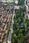 Nederland, Zuid-Holland, Den Haag, 15-07-2012; Sportlaan met flats uit de wederopbouw periode. Links de Vogelwijk..Aan weerszijden van de Sportlaan de 'Atlantikwall strook'. In dit gebied is tijdens de Tweede Wereldoorlog de bevolking geëvacueerd en de bebouwing ontruimd en/of gesloopt ivm aanleg tankgracht. .On both sides of the Sportlaan the Atlantic Wall strip. During the Second World War, the population of this area was evacuated and some of the buildings were demolished in order to build a antitank ditch. Post-war reconstruction appartment buildings...QQQ.luchtfoto (toeslag), aerial photo (additional fee required).foto/photo Siebe Swart