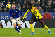 Ismaila Sarr (23) & Christian Fuchs (28) during the Premier League match between Leicester City and Watford at the King Power Stadium, Leicester, England on 4 December 2019.