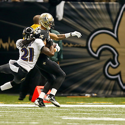 Nov 24, 2014; New Orleans, LA, USA; New Orleans Saints wide receiver Joe Morgan (13) is tackled by Baltimore Ravens cornerback Lardarius Webb (21) during the first quarter of a game at the Mercedes-Benz Superdome. Mandatory Credit: Derick E. Hingle-USA TODAY Sports