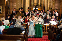 """Judy Buswell, Lea Mascio and Evelyn Smith sing """"There is Sunshine in My Soul Today"""" along with the chorus and audience at the Methodist Advent Christian Church in Lakeport on Sunday afternoon.  (Karen Bobotas/for the Laconia Daily Sun)"""