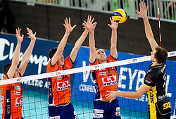 Dejan Vincic, Milan Rasic and Andrej Flajs of ACH vs Bartosz Kurek of Belchatow during volleyball match between ACH Volley LJUBLJANA and  PGE Skra Belchatow (POL) of 2012 CEV Volleyball Champions League, Men, League Round in Pool F, 4th Leg, on December 20, 2011, in Arena Stozice, Ljubljana, Slovenia. (Photo By Vid Ponikvar / Sportida.com)