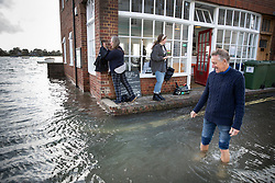 © Licensed to London News Pictures. 01/10/2019. Bosham, UK. People at the Breeze Cafe watch as high tide covers roads in the village of Bosham in West Sussex. Parts of the South are being affected by the aftermath of Hurricane Lorenzo with numerous flood warnings in place. Photo credit: Peter Macdiarmid/LNP