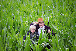 © Licensed to London News Pictures. 15/07/2016. York UK. Picture shows British Actress Julie Dawn Cole who played Veruca Salt in the 1971 film Willy Wonka & Farmer Tom Pearcy. This years York Maze has been launched today & farmer Tom Pearcy has dedicated this years design to author Roald Dahl to celebrate 100 years of Roald Dahl. The maze design which covers a 15 acre field is a montage of Roald Dahl characters including Willy Wonka, The BFG & The Fantasic Mister Fox. The  Photo credit: Andrew McCaren/LNP