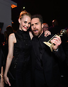 Leslie Bibb, left, and Sam Rockwell attend FOX 2018 Golden Globes After Party at The Beverly Hilton on Sunday, January 7, 2018, in Beverly Hills, Calif. (Photo by Jordan Strauss/JanuaryImages/Invision/AP)
