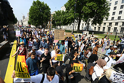 © Licensed to London News Pictures. 21/06/2017. London, UK. A protest is taking place Outside Downing Street that is aiming to bring down the Government. The Demonstration by Movement for Justice By Any Means Necessary is billed as a day of action for the victims of the Grenfell Tower disaster. Photo credit: Andrew McCaren/LNP