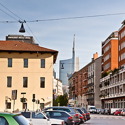 MILAN, ITALY - MAR 30: A street view of the city of Milan on March 30, 2012. The new Torre Garibaldi, inaugurated in October 2011, is the highest building in Italy.