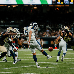 Aug 30, 2018; New Orleans, LA, USA; Los Angeles Rams place kicker Sam Ficken (5) is pressured by New Orleans Saints linebacker Nate Stupar (54) during the first half of a preseason game at the Mercedes-Benz Superdome. Mandatory Credit: Derick E. Hingle-USA TODAY Sports