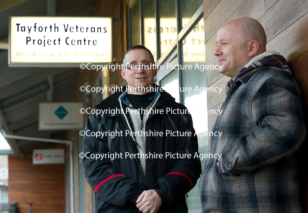 George MacDonald a former soldier with the Royal Highland Fusiliers, now a volunteer at the Tayforth Veterans Project Centre in Dundee pictured with former Black Watcher soldier Daniel O'Connor....20.12.11<br /> Picture by Graeme Hart.<br /> Copyright Perthshire Picture Agency<br /> Tel: 01738 623350  Mobile: 07990 594431