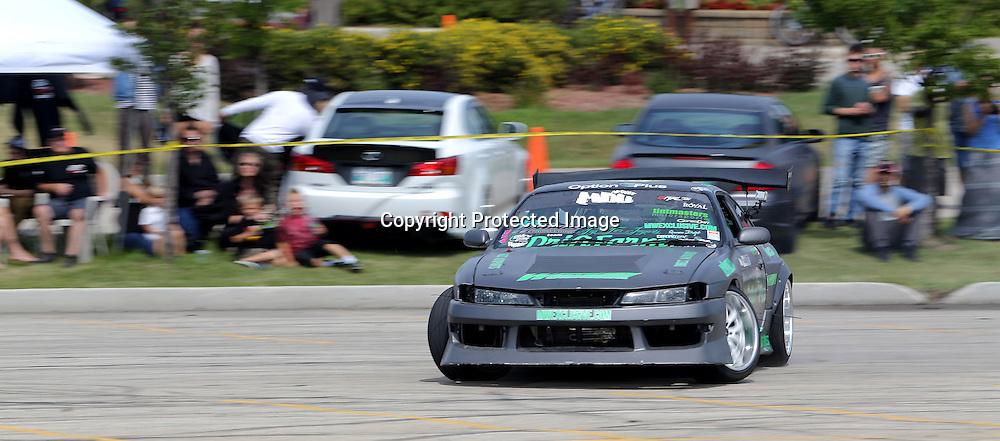 Chris Gonzales, a Formula Drift Pro Am driver, put on a drifting demo at Springs Church, Sunday, August 10, 2014. (TREVOR HAGAN/WINNIPEG FREE PRESS)